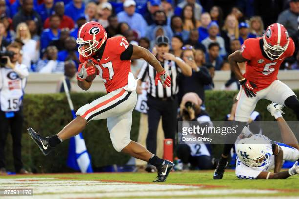Nick Chubb of the Georgia Bulldogs runs for a touchdown during the first half against the Kentucky Wildcats at Sanford Stadium on November 18 2017 in...