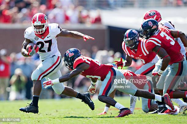 Nick Chubb of the Georgia Bulldogs runs the ball during a game against the Mississippi Rebels at VaughtHemingway Stadium on September 24 2016 in...