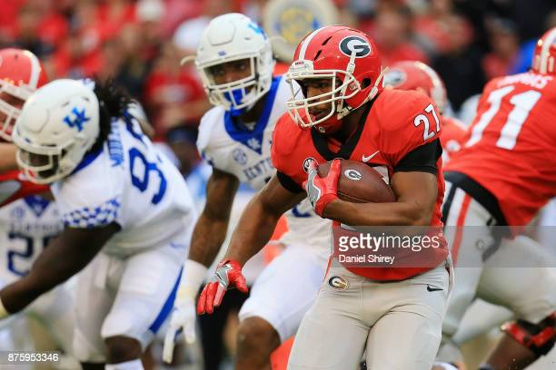 Nick Chubb of the Georgia Bulldogs runs the ball during the first half against the Kentucky Wildcats at Sanford Stadium on November 18 2017 in Athens...