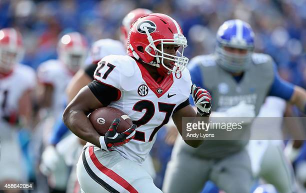 Nick Chubb of the Georgia Bulldogs runs with the ball during the game against the Kentucky Wildcats at Commonwealth Stadium on November 8 2014 in...