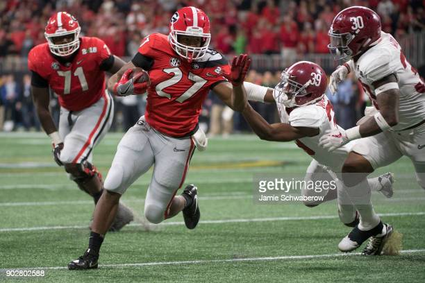Nick Chubb of the Georgia Bulldogs rushes against the Alabama Crimson Tide during the College Football Playoff National Championship held at...