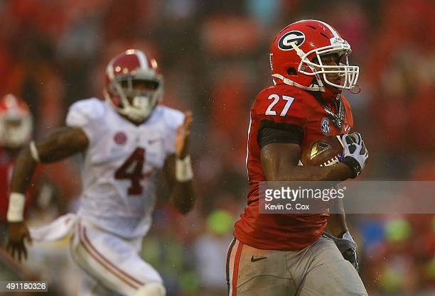 Nick Chubb of the Georgia Bulldogs rushes for a touchdown against the Alabama Crimson Tide at Sanford Stadium on October 3 2015 in Athens Georgia