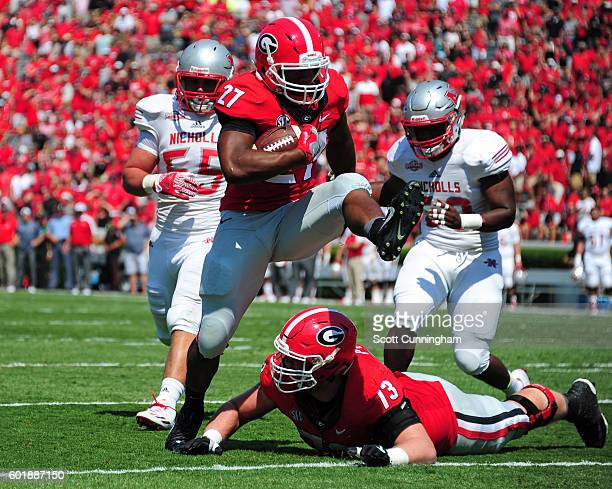 Nick Chubb of the Georgia Bulldogs scores a first quarter touchdown against the Nicholls Colonels at Sanford Stadium on September 10 2016 in Athens...
