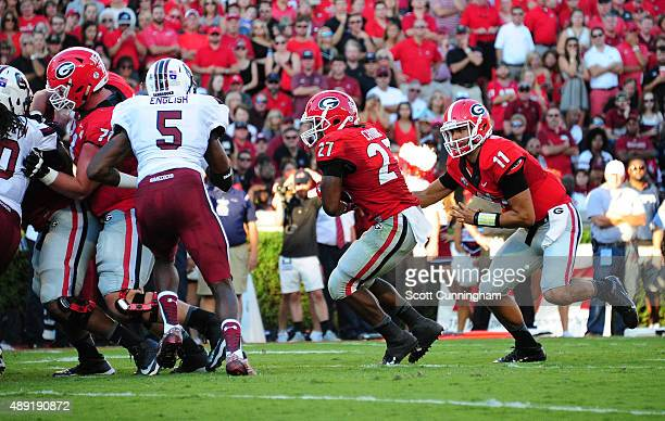 Nick Chubb of the Georgia Bulldogs takes a handoff from Greyson Lambert to score a second quarter touchdown against South Carolina Gamecocks on...