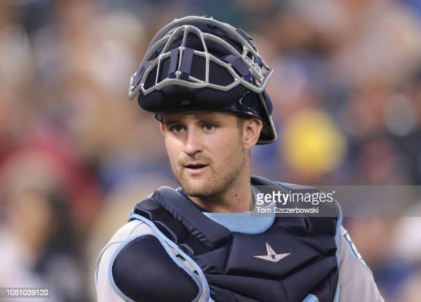 Nick Ciuffo of the Tampa Bay Rays lifts his mask as he looks on from behind home plate during MLB game action against the Toronto Blue Jays at Rogers...