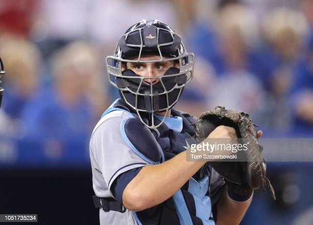 Nick Ciuffo of the Tampa Bay Rays looks through his mask from behind home plate during MLB game action against the Toronto Blue Jays at Rogers Centre...