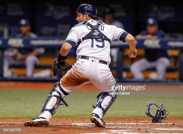 Nick Ciuffo of the Tampa Bay Rays looks to throw to a base after fielding a wild pitch in the fifth inning of a baseball game against the New York...