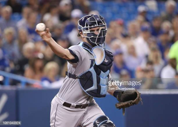Nick Ciuffo of the Tampa Bay Rays throws out the baserunner to complete the strikeout in the second inning during MLB game action against the Toronto...