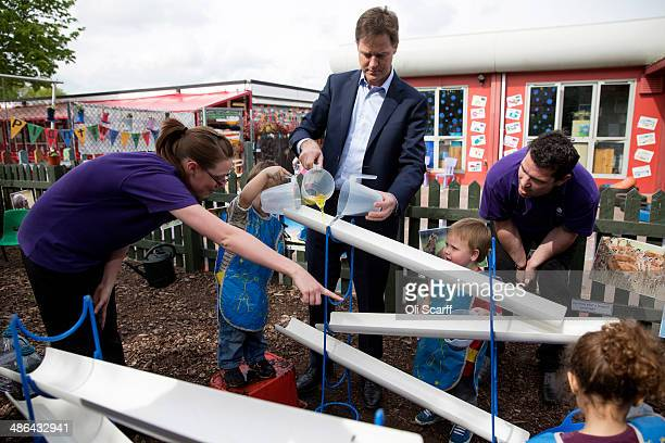 Nick Clegg the Deputy Prime Minister and leader of the Liberal Democrats mixes blue and yellow liquids at Nannas Day Nursery on the day he launched...