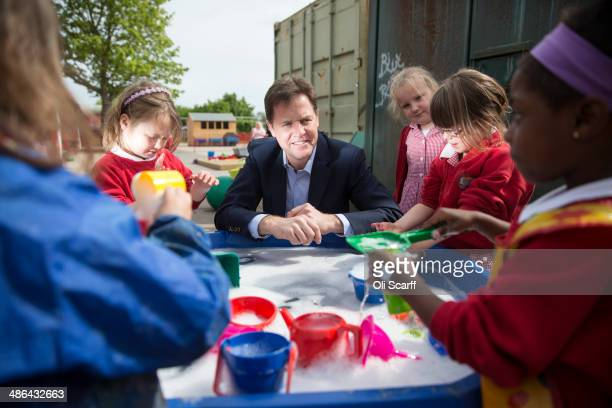Nick Clegg the Deputy Prime Minister and leader of the Liberal Democrats speaks to children at Hazelmere Infant School on the day he launched the...
