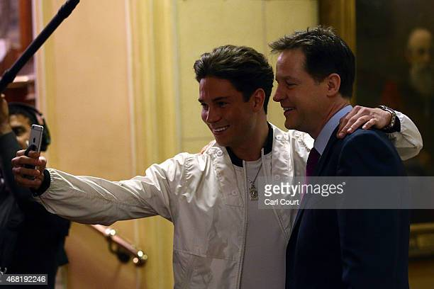 Nick Clegg the leader of the Liberal Democrat party has a selfie photograph taken with reality television star Joey Essex after announcing the...