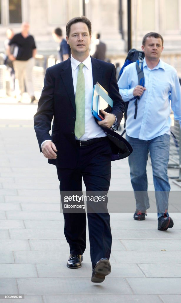 Nick Clegg, U.K. deputy prime minister, walks past the H.M.Treasury building in London, U.K., on Monday, May 24, 2010. British Prime Minister David Cameron's two-week old coalition is taking its first steps to curb a record peacetime budget deficit today by announcing 6 billion pounds ($8.7 billion) of spending cuts. Photographer: Rupert Hartley/Bloomberg via Getty Images