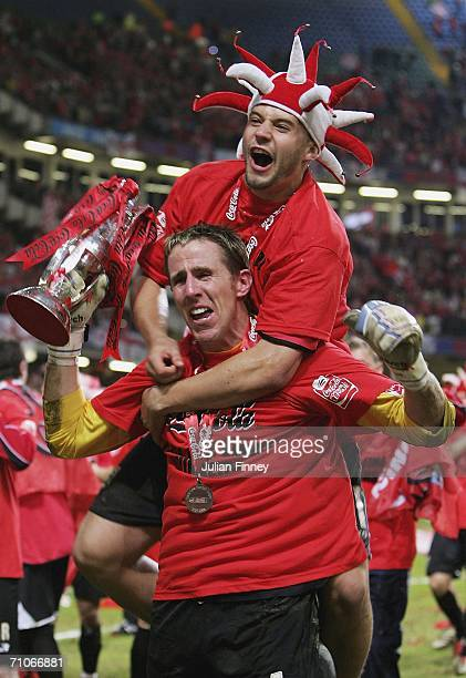 Nick Colgan goalkeeper of Barnsley celebrates with a teammate after gaining promotion to the championship after the League One Playoff Final match...