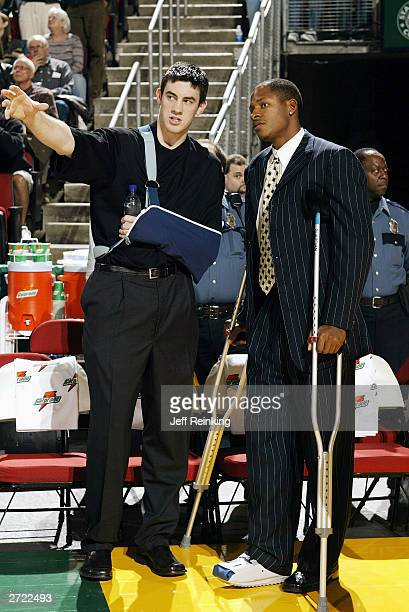Nick Collison and Ray Allen of the Seattle Sonics talk before the game at Key Arena against the Atlanta Hawks on November 7 2003 in Seattle...