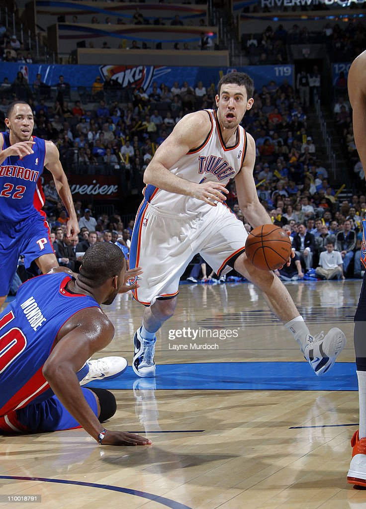 Nick Collison #4 of the Oklahoma City Thunder drives to the basket against Tayshaun Prince #22 of the Detroit Pistons during the game on March 11, 2011 at the Oklahoma City Arena in Oklahoma City, Oklahoma.