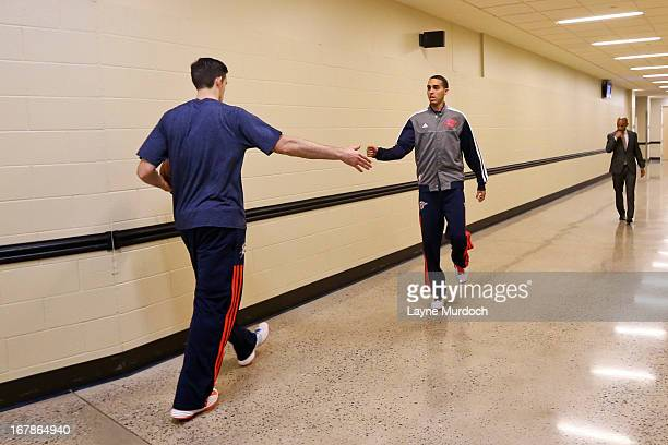 Nick Collison of the Oklahoma City Thunder greets teammate Kevin Martin outside the locker room before playing against the Houston Rockets in Game...