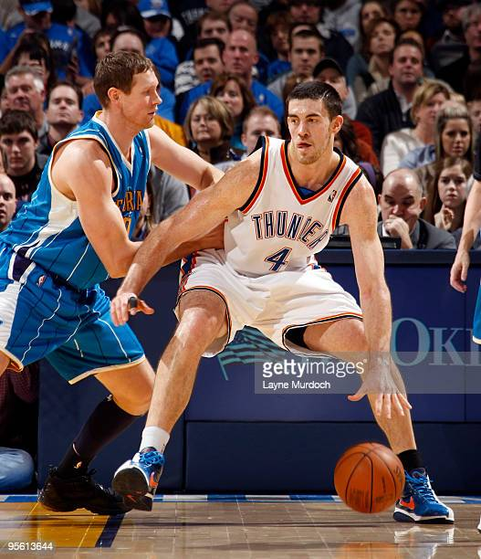 Nick Collison of the Oklahoma City Thunder is guarded by Darius Songaila of the New Orleans Hornets on January 6 2010 at the Ford Center in Oklahoma...