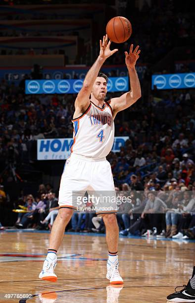 Nick Collison of the Oklahoma City Thunder passes the ball against the New Orleans Pelicans during the game on November 18 2015 at Chesapeake Energy...