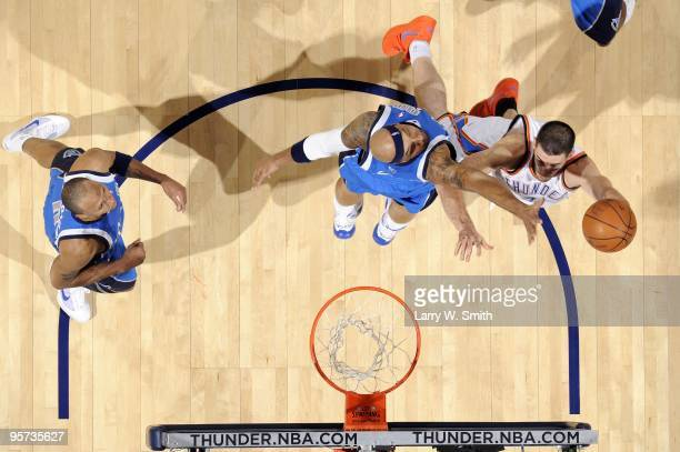 Nick Collison of the Oklahoma City Thunder shoots a layup against Drew Gooden of the Dallas Mavericks during the game at Ford Center on December 16...
