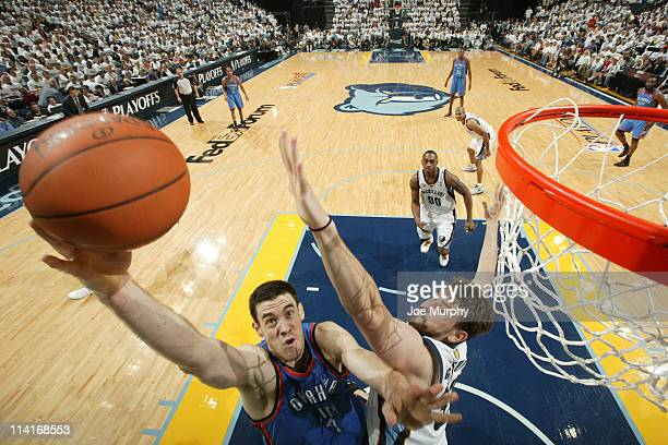Nick Collison of the Oklahoma City Thunder shoots against Marc Gasol of the Memphis Grizzlies during Game Six of the Western Conference Semifinals in...