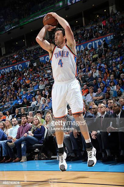 Nick Collison of the Oklahoma City Thunder shoots against the Denver Nuggets during a preseason game on October 18 2015 at Chesapeake Energy Arena in...