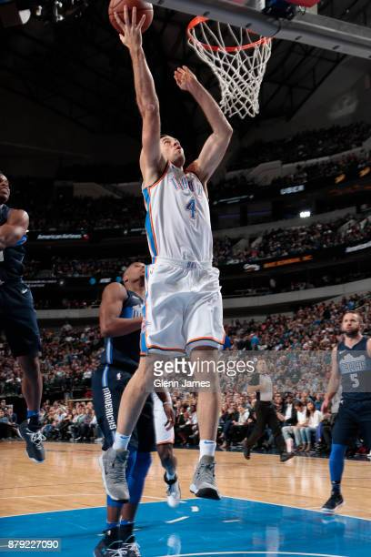 Nick Collison of the Oklahoma City Thunder shoots the ball against the Dallas Mavericks on November 25 2017 at the American Airlines Center in Dallas...