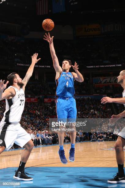 Nick Collison of the Oklahoma City Thunder shoots the ball against the San Antonio Spurs on March 10 2018 at Chesapeake Energy Arena in Oklahoma City...