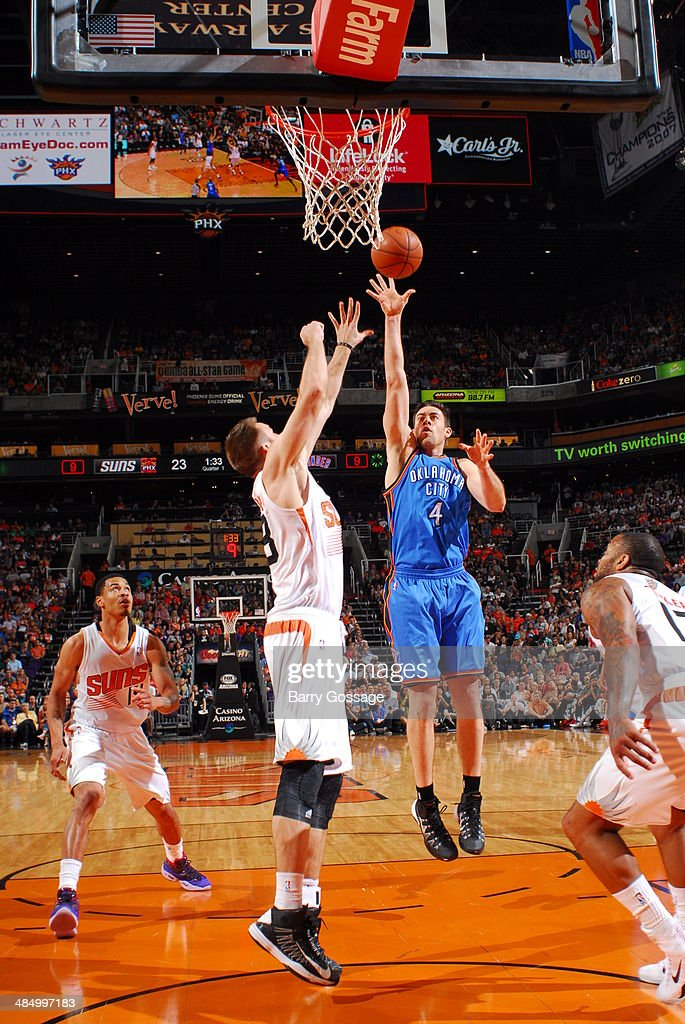 Nick Collison #4 of the Oklahoma City Thunder takes a shot against the Phoenix Suns on April 6, 2014 at U.S. Airways Center in Phoenix, Arizona.