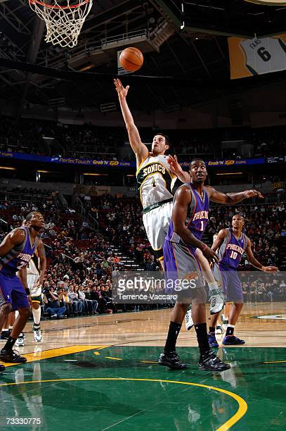 Nick Collison of the Seattle SuperSonics goes to the basket past the defense of Amare Stoudemire of the Phoenix Suns on February 14 2007 at the Key...