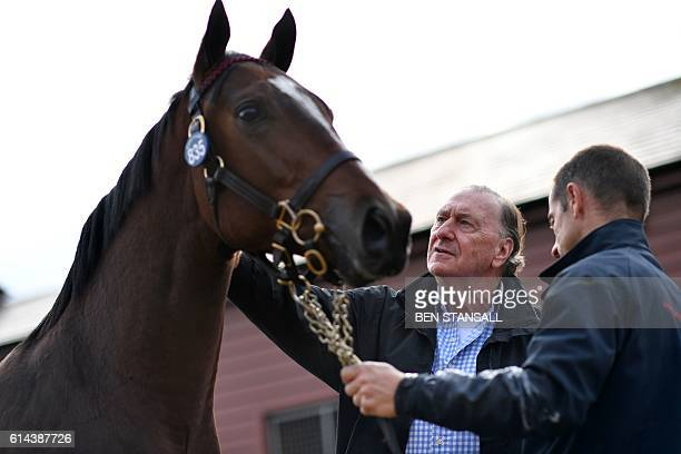 Nick Columb of the Hong Kong Jockey Club poses with his sale catalogue at the Tattersalls Bloodstock Auction in Newmarket north of London on October...