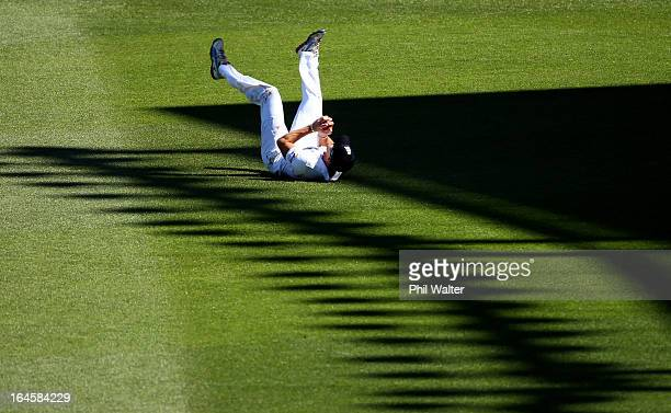 Nick Compton of England catches out BJ Watling of New Zealand during day four of the Third Test match between New Zealand and England at Eden Park on...