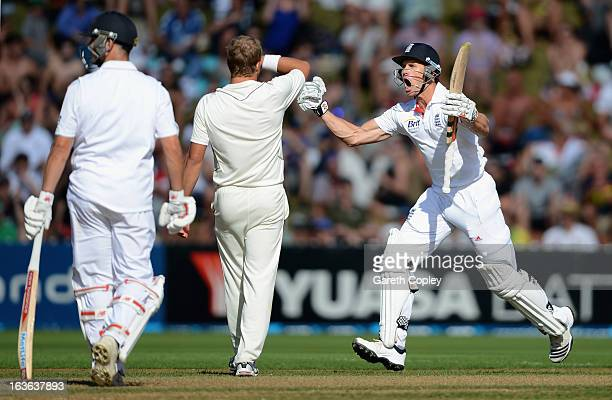 Nick Compton of England celebrates reaching his century during day one of the 2nd Test match between New Zealand and England at Basin Reserve on...