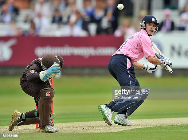 Nick Compton of Middlesex tips the ball past Gary Wilson of Surrey during the Twenty20 Cup match between Middlesex and Surrey at Lords on May 25 2009...
