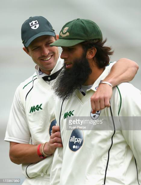 Nick Compton of Worcestershire and Moeen Ali of Worcestershire walk from the ground at tea during day one of the Tour Match between Worcestershire...