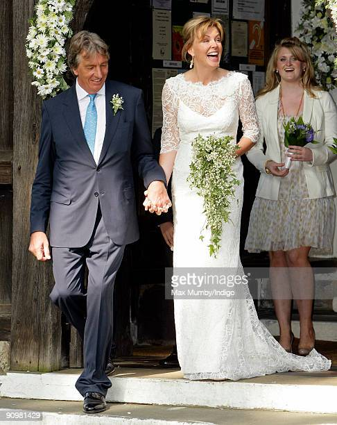 Nick Cook and Eimear Montgomerie exwife of golfer Colin Montgomerie leaves St Nicholas Church after their wedding on September 20 2009 in Cranleigh...