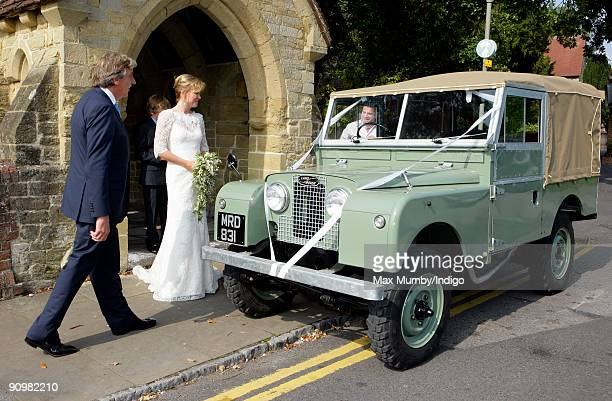 Nick Cook and Eimear Montgomerie leave St Nicholas Church in a canvas roofed Land Rover after their wedding on September 20 2009 in Cranleigh England