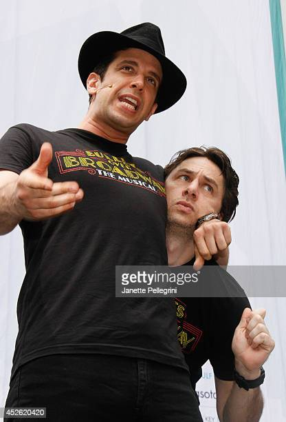 Nick Cordero and Zach Braff from the cast of Bullets Over Broadway perform during 1067 LITE FM's Broadway in Bryant Park 2014 at Bryant Park on July...