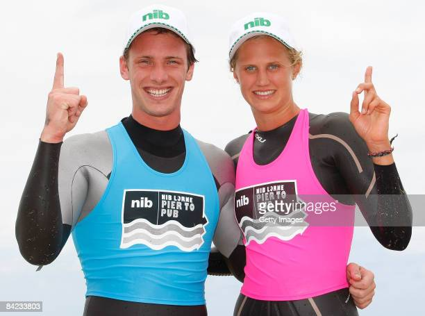 Nick Cordner and Harriet Brown pose after winning the Male and Female Open category during the Lorne Pier To Pub open water swim at Louttit Bay on...