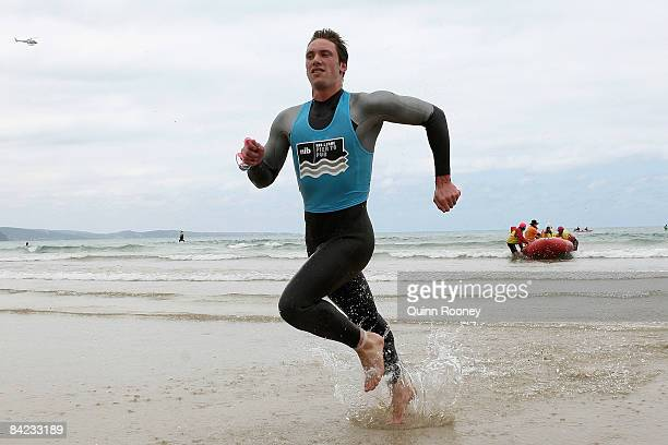 Nick Cordner of Victoria runs out of the water to win the Male Open during the Lorne Pier To Pub open water swim at Louttit Bay January 10 2009 in...