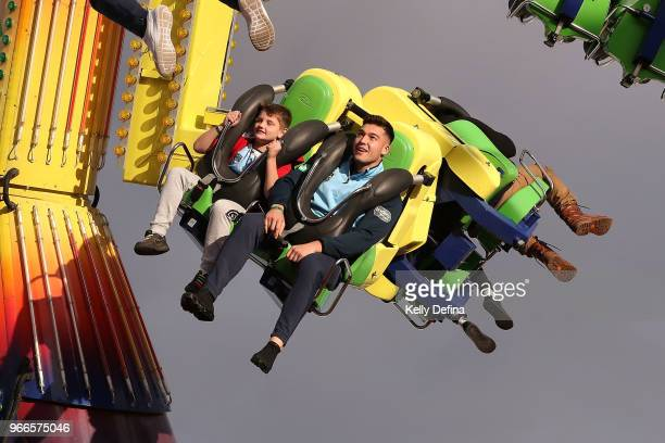 Nick Cotric of the Blues enjoys a ride with a young fan during a New South Wales Blues State of Origin Media Opportunity at Luna Park on June 3 2018...