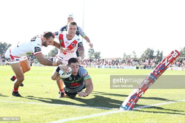 Nick Cotric of the Raiders scores a try during the round 11 NRL match between the St George Illawarra Dragons and the Canberra Raiders at Glen Willow...