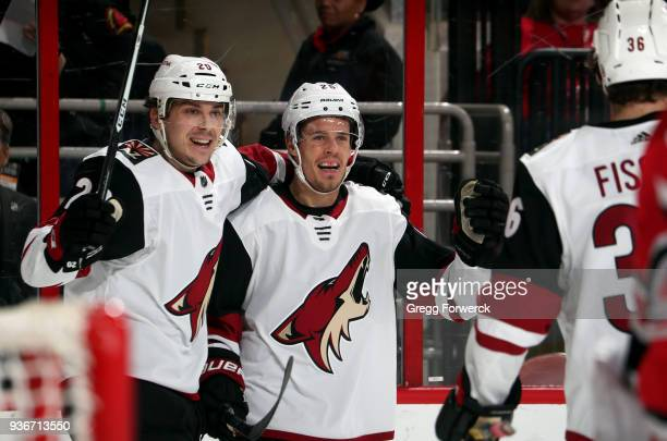 Nick Cousins of the Arizona Coyotes celebrates his second period goal against the Carolina Hurricanes with teammate Dylan Strome during an NHL game...