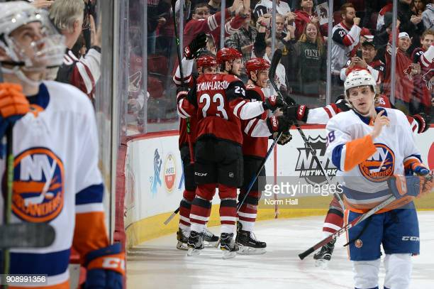 Nick Cousins of the Arizona Coyotes celebrates with teammates Brad Richardson and Oliver EkmanLarsson after his first period goal against the New...