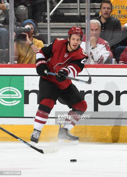 Nick Cousins of the Arizona Coyotes passes the puck against the New York Islanders at Gila River Arena on December 18 2018 in Glendale Arizona