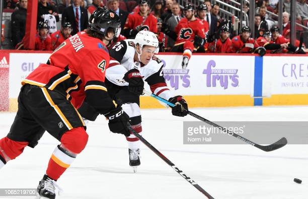 Nick Cousins of the Arizona Coyotes passes the puck in front of Rasmus Andersson of the Calgary Flames during the third period at Gila River Arena on...