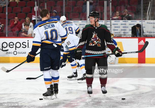 Nick Cousins of the Arizona Coyotes talks with Brayden Schenn of the St Louis Blues prior to the start of a game at Gila River Arena on December 1...
