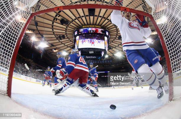 Nick Cousins of the Montreal Canadiens celebrates the game winning goal by Nate Thompson against Alexandar Georgiev of the New York Rangers at...