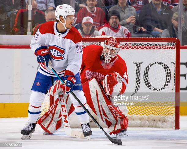 Nick Cousins of the Montreal Canadiens sets up in front of Jonathan Bernier of the Detroit Red Wings during an NHL game at Little Caesars Arena on...