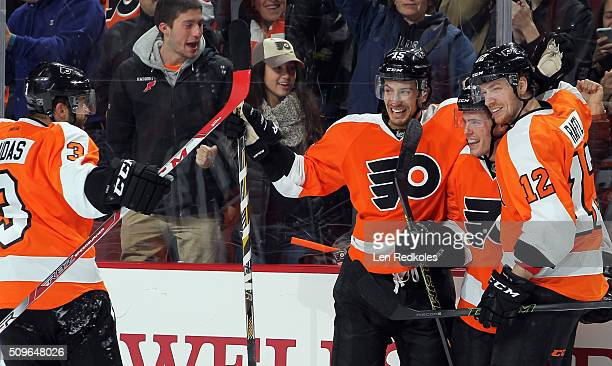 Nick Cousins of the Philadelphia Flyers celebrates his third period goal against the Buffalo Sabres his first goal in the NHL with teammates Radko...