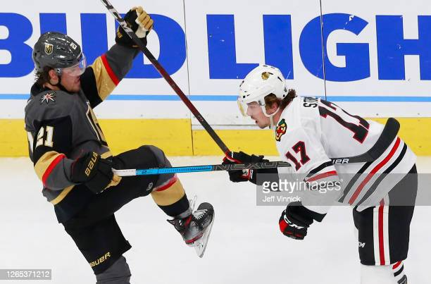 Nick Cousins of the Vegas Golden Knights and Dylan Strome of the Chicago Blackhawks tangle during the second period in Game One of the Western...